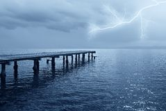 Lightning over the ocean. Lightning in the night on the sea Stock Photography