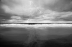 Lightning Over the Ocean. Cloud-to-ground lightning bolts are a common phenomenon, about 100 strike Earth's surface every single second—yet their power is Stock Image