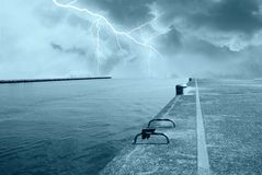 Lightning over the ocean. From the pier Royalty Free Stock Photos