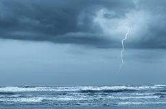 Lightning over the ocean. Ocean with lightning in the sky Stock Images