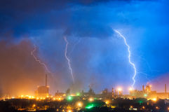 Lightning over the plant. Labor weekday during lightning in the evening Royalty Free Stock Image