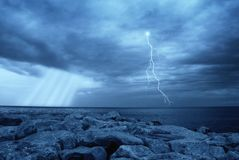 Lightning over the sea Stock Images