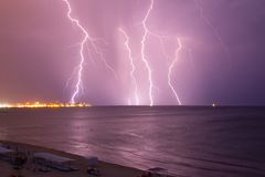 Lightning over the sea before the storm stock photo