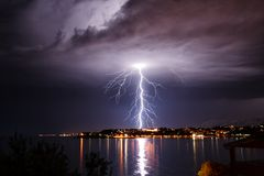 Lightning over the seaside. Storm on the coast of Adriatic, Croatia Stock Photos