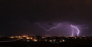 Lightning over small town Stock Images