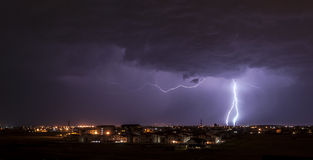 Lightning over small town Stock Photo