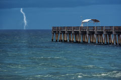 Lightning over water. Lightning strikes over the ocean (long single exposure Royalty Free Stock Photos