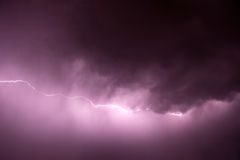 Lightning with purple tint stock photo