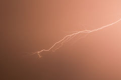 lightning in red background Stock Images