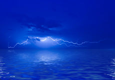 Lightning with reflection in the water surface Stock Photos