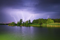 Lightning on the river Royalty Free Stock Images
