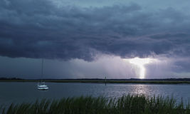 Lightning and sailboat Stock Images
