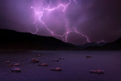 Lightning. In sea bay with boats Stock Image