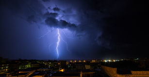 lightning on the sea in the night over a Little City Stock Images