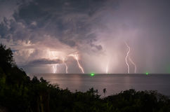 Lightning in the sea during the night storm royalty free stock photo