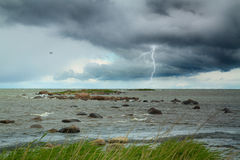 Lightning at sea. summer storm coming ashore. Stock Image
