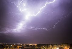 Lightning Seeker. Thunderstorm over the city. The force of nature Stock Image