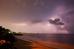 Lightning show above horizon at seashore Stock Images