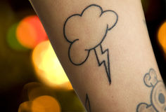 Lightning and sky tattoo. On human skin royalty free stock photos