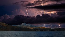Lightning over Karadag. Eastern Crimea, near Feodosia. Lightning sparkle over the Black Sea, Eastern Crimea, near Feodosia and Koktebel stock photography