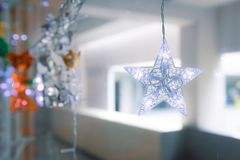 Lightning Stars hanging with copy space for decoration during the winter time for Christmas. royalty free stock images