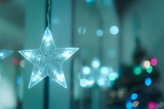 Lightning Stars hanging with copy space for decoration during the winter time for Christmas. stock photography