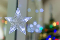 Lightning Stars hanging with copy space for decoration during the winter time for Christmas. royalty free stock image