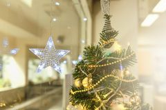Lightning Stars hanging with copy space for decoration during the winter time for Christmas. stock photos