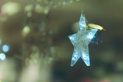Lightning Stars hanging with copy space for decoration during the winter time for Christmas. stock photo