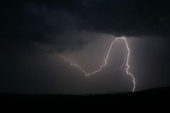 Lightning stike 1. Lightning strike within a thunderstorm at night Royalty Free Stock Images