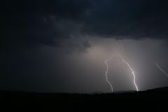 Lightning stike 2. Lightning strike within a thunderstorm at night Royalty Free Stock Images