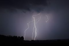 Lightning stike 4. Lightning strike within a thunderstorm at night Stock Image