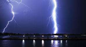 Lightning storm. Amazing lightning storm over a pier in Nassau, The Bahamas Stock Image