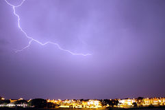 Lightning Storm. Brilliant bolt of lightning over several buildings Stock Photography