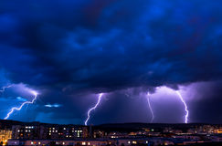 Lightning. The storm is coming over the city Stock Image