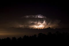 Lightning Storm at Night. A Texas lightning storm makes the clouds glow at night Stock Image