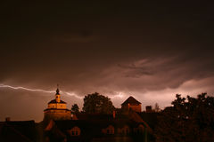 Lightning in a storm in old medival city with castle and a chapel (Kamnik, Slovenia) Stock Photo
