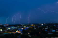 Lightning storm over city in blue light Royalty Free Stock Photography