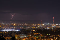 Lightning storm over city at night Stock Photography