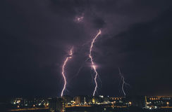 Lightning storm over countryside city at night in Thailand Royalty Free Stock Photography
