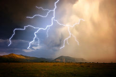 Lightning in a storm. Over mountains royalty free stock photography