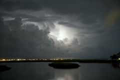 Lightning Storm over Murrells Inlet. Dramatic Clouds backlit at night by approaching lightning storm Royalty Free Stock Photo