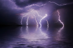 Lightning storm over ocean. At night Royalty Free Stock Photo