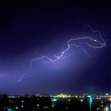 Lightning Strike. In the night over a city Royalty Free Stock Image