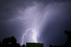 Lightning Strike. A bolt of lightning strikes a building Royalty Free Stock Images