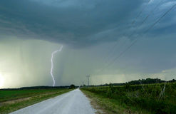 Lightning Strike Along a Country Road Stock Images