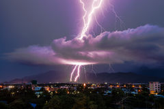 Lightning strike on the city mountain Stock Photos