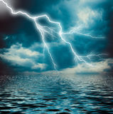 Lightning strike on the dark cloudy sky Royalty Free Stock Photo