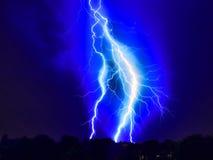 Lightning strike on the dark cloudy sky Stock Images