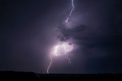 Lightning Strike. Dramatic big lightning striking down to the earth Royalty Free Stock Image